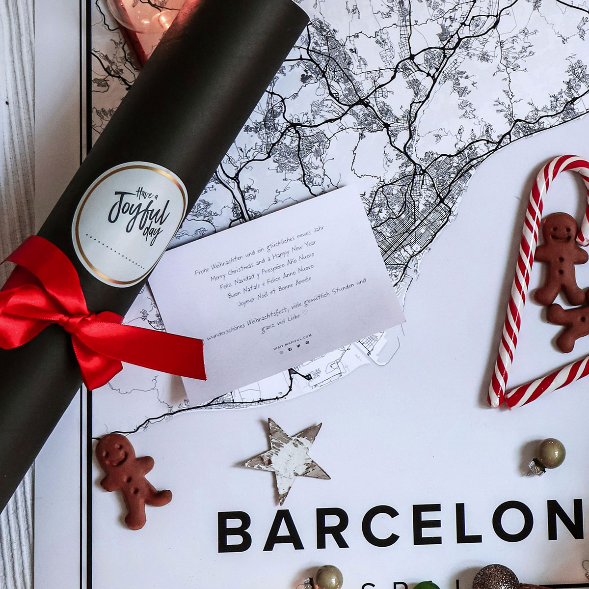 A non branded beautiful black gift tube, and the personal gift note.